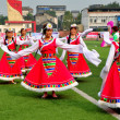 Stock Photo: Pengzhou, China: Women Performing TibetDance Routine