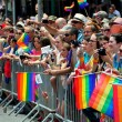 NYC:  Spectators with Rainbow Flags at Gay Pride Parade — Stock Photo
