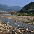 Stock Photo: SichuProvince, China: Rock Strewn JiJiang River