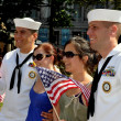 Stock Photo: NYC: Two Women Pose with AmericSailors at Battery Park