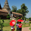 Lampang, Thailand: Three Women with Parasols at Wat Phra That Lampang Luan — Stock Photo