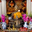 Stock Photo: Bangkok, Thailand: Buddhas and Offerings at Wat Arun