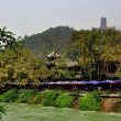 Stock Photo: Dujiangyan, China: Cafes along the Min River and Hilltop Pagoda
