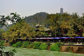 Dujiangyan, China: Cafes along the Min River and Hilltop Pagoda — Stock Photo