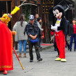 Постер, плакат: Langzhong China: Monkey King and Mickey Mouse on Wumiao Street