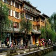 Dujiangyan, China: Elegant Wooden Houses Overlooking Canal — Stock Photo