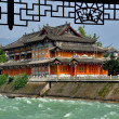 Dujiangyan, China: Tea House and Min River — Stock Photo