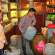Langzhong, China:  Shopkeeper Pouring Vinegar — Stock Photo