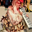 Stock Photo: Bangkok, Thailand: Chicken MusiciEntertains Crowds on Children's Day Holiday