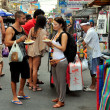 Bangkok, Thailand: Tourists Eating Pad Thai Noodles on Khao San Road — Stock Photo #36143873