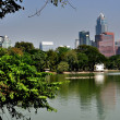 Stock Photo: Bangkok, Thailand: View Across Lumphini Park Lake to Suhamvit Skyline