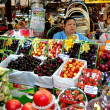 Stock Photo: Bangkok, Thailand: WomSelling Fruit at Or Tor Kor Market