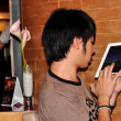 Bangkok, Thailand: Thai Teenager using High-Tech Pad — Stock Photo