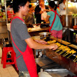 Stock Photo: Bangkok, Thailand: MGrilling Chicken Satay