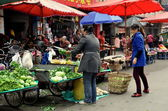 Pengzhou, China: Women Selling Produce at Outdoor Market — Stockfoto