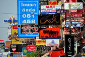 Bangkok, Thailand: A Barrage of Signs on Khao San Road — Stock Photo