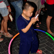 Chiang Mai, Thailand: Little Boy with Cell Phone and Hula Hoop — Stock Photo