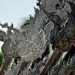 Chiang Mai, Thailand: Silvered Tin Dragons on VihRoof at WatSri Suphan — Stock Photo #36611335
