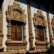 Stock Photo: Chiang Mai, Thailand: Opulent Ubosot Windows at Wat Thatsatoi