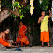 Постер, плакат: Chiang Mai Thailand: Young Monks Stringing Lights at Wat Phan Tao