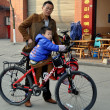 Pengzhou, China: Father and Son with Bicycle — Stock Photo #36743277