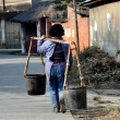 Pengzhou, China:  Woman Carrying Water Buckets — Stock Photo