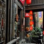 Постер, плакат: Chengdu China: Jin Li Street Wooden Buildings with Shops and Restaurants
