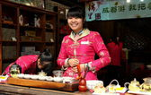 Chengdu, China: Sales Clerk at Tea Shop on Jin Li Street — Stock Photo