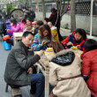 Stock Photo: Chengdu, China: People Eating at Jin LI Street