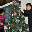 Pengzhou, China: Chinese mother and son Decorating Christmas Tree — Stock Photo
