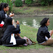 Stock Photo: Bangkok, Thailand: Four Women Eating Lunch in Lumphini Park