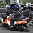 Stock Photo: Bangkok, Thailand: Motorcyclists Waiting for Traffic Light