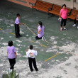Stock Photo: Bangkok, Thailand: Children Playing Jump Rope
