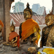 Stock Photo: Bangkok, Thailand: Four Seated Buddhas at Wat HuLamphong