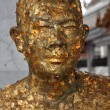 Stock Photo: Bangkok, Thailand: Monk Statue Covered with Gold Leaf
