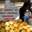 Stock Photo: Bangkok, Thailand: Don't Squeeze Mangoes Sign on Food Cart