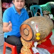 Stock Photo: Bangkok, Thailand: MusiciPlaying Drum at ErawShrine