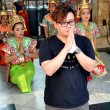 Stock Photo: Bangkok, Thailand: MPraying at ErawShrine
