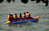 Pattaya, Thailand: People Riding a Banana Boat — Stock Photo
