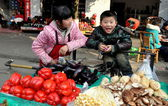 Pengzhou, China: Little Boy at Tian Fu Market — Stock Photo