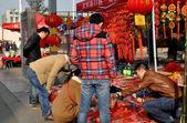 Pengzhou, China: Youths Buying New Year Decorations — Stock Photo