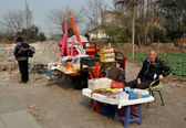 Pengzhou, China: Man Selling Sundries and Fireworks — Stock Photo