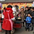 Pengzhou, China: Family Buying Street Food from Vendor — Stock Photo