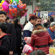 Stock Photo: Pengzhou, China: People and Food Vendors at City Park