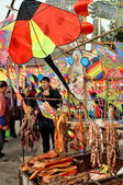 Pengzhou, China: New Year Kites and Vendor Stand Selling Meats — Foto Stock