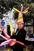 Pengzhou, China: Vendor Wearing Balloon Hat — Stock Photo