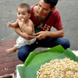 Pattaya, Thailand: Peanut Seller with Toddler Son — Stock Photo #40194741