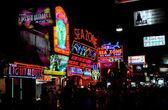 Pattaya, Thailand: Neon Signs on Night Walking Street — Stock Photo