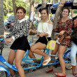 Bang Saen, Thailand: Four Women Riding Bicycle — Stock Photo #40400075
