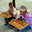 Постер, плакат: Bang Saen Thailand: Two Women Selling Food on Beach Promenade